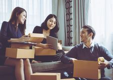 Start up team of online retailer packing boxes to send to customer. Start up team of online retailer packing boxes to send out to customer Stock Photo