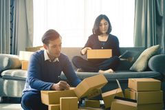 Start up team of online retailer packing boxes to send to customer. Start up team of online retailer packing boxes to send out to customer Stock Images
