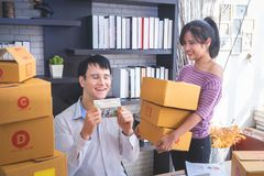 Start up team of online retailer packing boxes to send out to cu royalty free stock photos