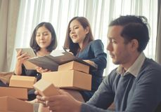 Start up team retailer packing boxes to send out to customer. Start up team of online retailer packing boxes to send out to customer Royalty Free Stock Photo