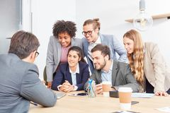 Start-up team in a training or presentation. Business start-up team in a training or presentation with a consultant stock photos