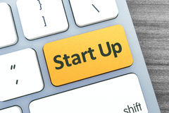 Start Up Text on a Button on Modern Computer Keyboard. Top view Stock Photo