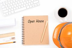 Start up word with modern workplace on white background. Open house concept on notebook with glasses, pencil and coffee cup on wooden table. Business concept royalty free stock photo