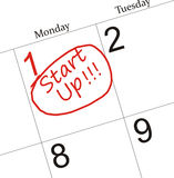 Start Up. Words circle marked on a calendar by a red pen stock illustration