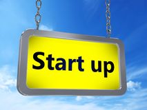 Start up on billboard. Start up on yellow light box billboard on blue sky background Royalty Free Stock Photography