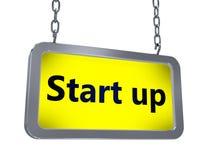 Start up on billboard. Start up on yellow light box billboard on white background Royalty Free Stock Photography