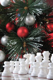 Start. White chess in Christmas decoration Royalty Free Stock Photography