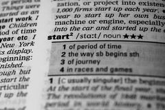 Start word in dictionary. (Selective focus Stock Photo