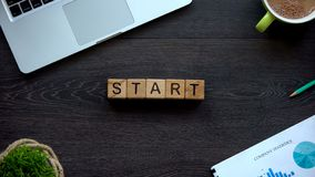 Start, word made on wooden cubes, beginning of new life, motivation for future. Stock photo stock photo