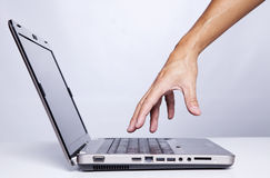 Start working with my laptop computer. Hand gesture next to a laptop (selective focus Royalty Free Stock Images