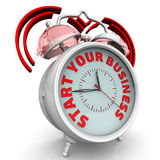 Start your business. The alarm clock with an inscription. Alarm clock with the red words `START YOUR BUSINESS`. 3D Illustration Royalty Free Stock Photos