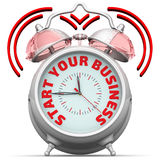 Start your business. The alarm clock with an inscription. Alarm clock with the red words `START YOUR BUSINESS`. 3D Illustration. Isolated Stock Photos