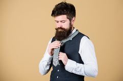 Start with your collar up and the tie around your neck. How to tie simple knot. Art of manliness. Man bearded hipster. Try to make knot. Different ways of tying royalty free stock photo