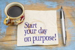Start your day on purpose!. A motivational advice or reminder on a napkin with a cup of coffee Stock Photos