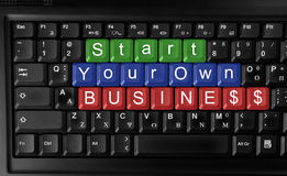 Start your own business. Laptop keyboard ,text start your own business  colored keys Royalty Free Stock Images