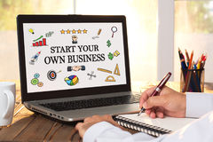 Start Your Own Business Concept On Laptop Monitor. Start Your Own Business Concept With Various Hand Drawn Doodle Icons On Laptop Screen stock image