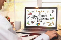 Start Your Own Business Concept On Laptop Monitor. Start Your Own Business Concept With Various Hand Drawn Doodle Icons On Laptop Screen royalty free stock photo