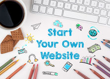 Start Your Own Website, Business concept. White office desk Royalty Free Stock Photo