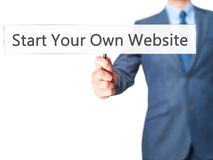 Start Your Own Website - Business man showing sign Stock Photography