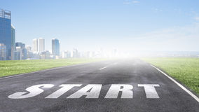 Start your way. Conceptual image with word start on asphalt road Stock Photos
