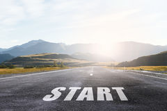 Start your way. Conceptual image with word start on asphalt road Royalty Free Stock Image