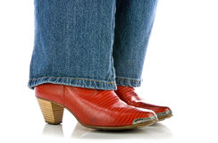 startar white för red för cowboyjeansben slitage Arkivbilder