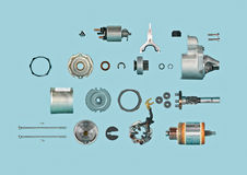 Starter. Reverse engineering starter for car on blue background; spare parts for cars Royalty Free Stock Image
