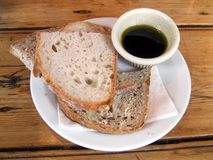 Starter. Appetizer. Food dressing of balsamic vinegar with olive oil and bread Stock Images