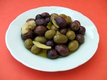Starter. appetizer. olives on a plate of crockery Royalty Free Stock Image