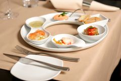 Starter or Entree of a french dish. With fish, seafood mixed and foie gras Stock Image
