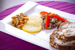 Starter with fried prawns. With lemon, mashrooms and brown bread Stock Photo