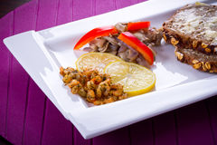 Starter with fried prawns and lemon. Starter with fried prawns with lemon, mashrooms and brown bread Royalty Free Stock Photography