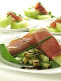 Starter with ham and melon Stock Photos