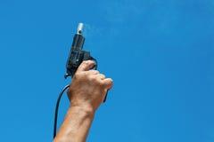 Starter. Hand firing a gun for starting race Stock Photos