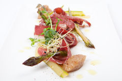 Starter with marinated green asparagus and smoked duck breast Royalty Free Stock Photography