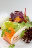 Starter with salmon tartare, Caviar and salad Stock Images