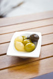 Olives and onions Stock Images