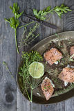 Starters with salmon butter seeds lemon and herbs on bread Royalty Free Stock Photography