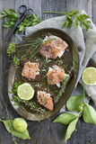 Starters with salmon butter seeds lemon and herbs on rye bread Stock Photos