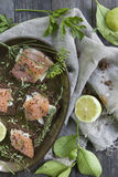 Starters with salmon butter seeds lemon and herbs on rye bread Royalty Free Stock Images