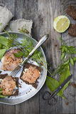 Starters with salmon butter seeds lemon and herbs on rye bread Royalty Free Stock Image