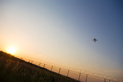 Starting airplane in front of a the evening sun. A starting airplane in front of a the evening sun Stock Image