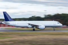 Starting airplane speed blur. A starting airplane speed blur Royalty Free Stock Photo