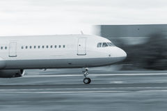 Starting airplane speed blur Stock Photography