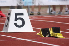 Starting block. With number five Royalty Free Stock Photography