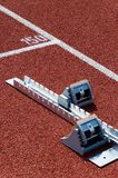Starting block. On a red running track Royalty Free Stock Photos