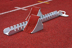 Starting Block Athletic. Athletics Starting Blocks on a red running track in a stadion Stock Photo