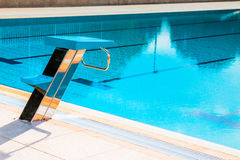 Starting block at the edge of a swimming pool. Close up of swimming pool starting block outdoors. Swimming competition concept stock photos