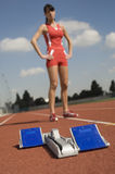 Starting Block With Female Athlete In Background Royalty Free Stock Photography