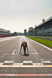 Starting block at Monza race track. Having some fun at Monza race track while no car was around the circuit - Simulating a starting block on the starting grid Royalty Free Stock Photography